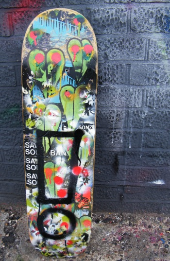 Exclaiming on an unwanted skateboard deck (Sean, August 2013)