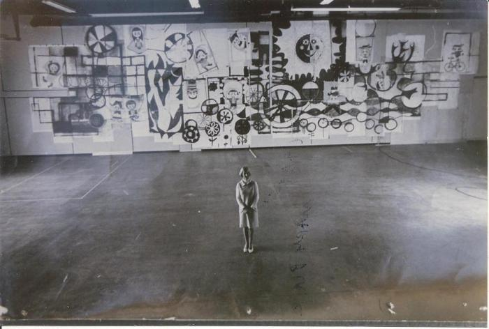 Mary Blair stands before her Tomorrowland mural design; 6.38 x 9.5 in (16.19 x 24.13 cm); Courtesy of the Blair Estate