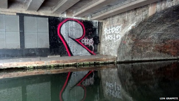 Team Robbo have painted an R on the canal in tribute to the artist